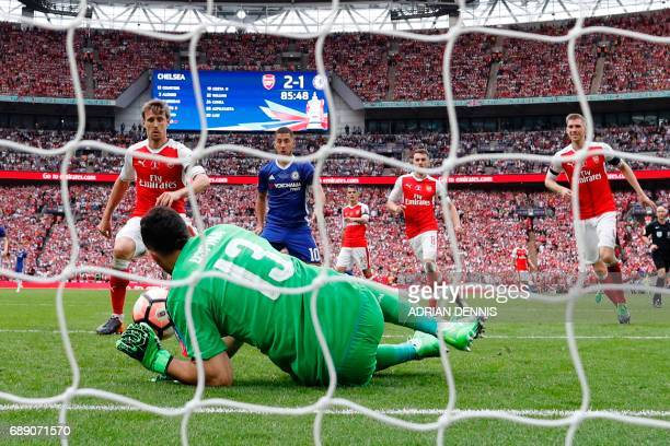 Arsenal's Colombian goalkeeper David Ospina makes a save from Chelsea's Brazilianborn Spanish striker Diego Costa during the English FA Cup final...