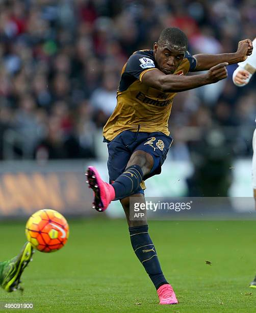 Arsenal's Costa Rican striker Joel Campbell has an unsuccessful shot on goal during the English Premier League football match between Swansea City...