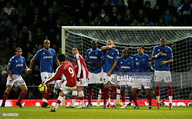 Arsenal's Croatian striker Eduardo scores a goal during their English Premier League football match against Portsmouth at Fratton Park Portsmouth...