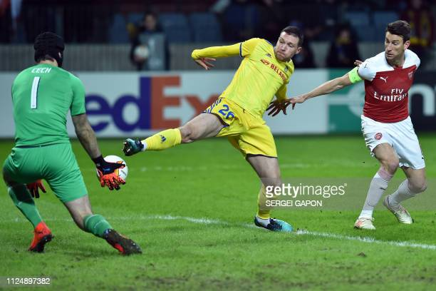 Arsenal's Czech goalkeeper Petr Cech BATE Borisov's Serbian forward Nemanja Milic and Arsenal's French defender Laurent Koscielny in action during...