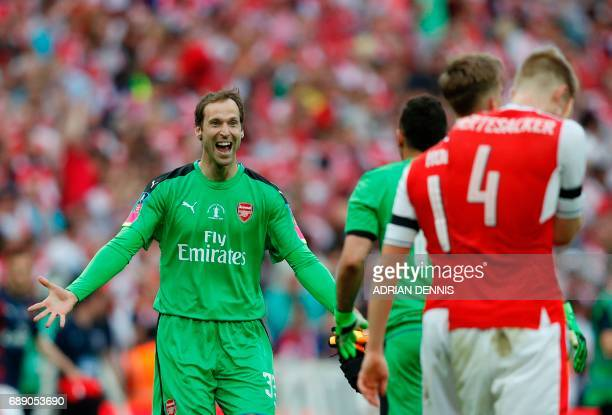 Arsenal's Czech goalkeeper Petr Cech celebrates with his teammates on the pitch after the English FA Cup final football match between Arsenal and...