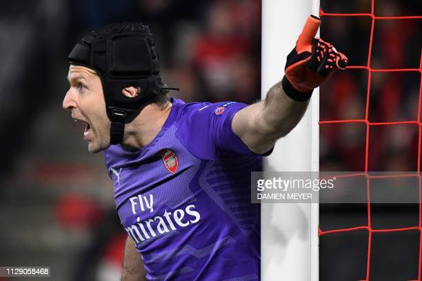 Arsenal's Czech goalkeeper Petr Cech gestures during the UEFA Europa League round of 16 first leg football match between Stade Rennais FC and Arsenal...