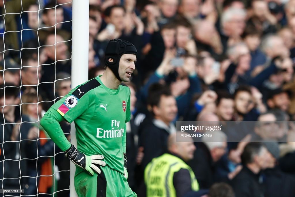 Arsenal's Czech goalkeeper Petr Cech reacts after Chelsea's Spanish midfielder Cesc Fabregas scored their third goal during the English Premier League football match between Chelsea and Arsenal at Stamford Bridge in London on February 4, 2017. / AFP / Adrian DENNIS / RESTRICTED TO EDITORIAL USE. No use with unauthorized audio, video, data, fixture lists, club/league logos or 'live' services. Online in-match use limited to 75 images, no video emulation. No use in betting, games or single club/league/player publications. /