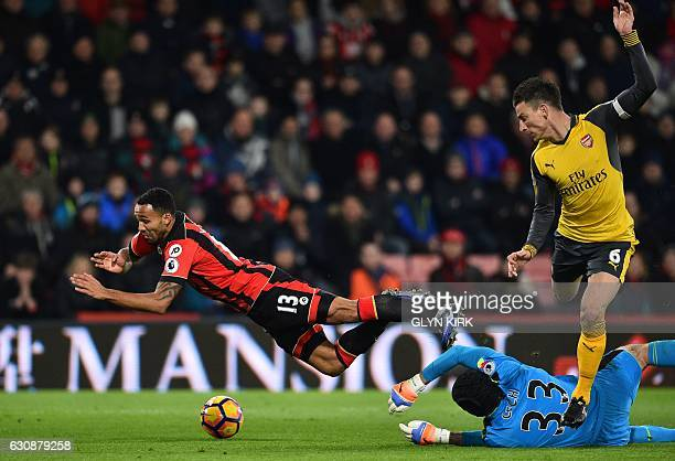 TOPSHOT Arsenal's Czech goalkeeper Petr Cech saves at the feet of Bournemouth's English striker Callum Wilson during the English Premier League...