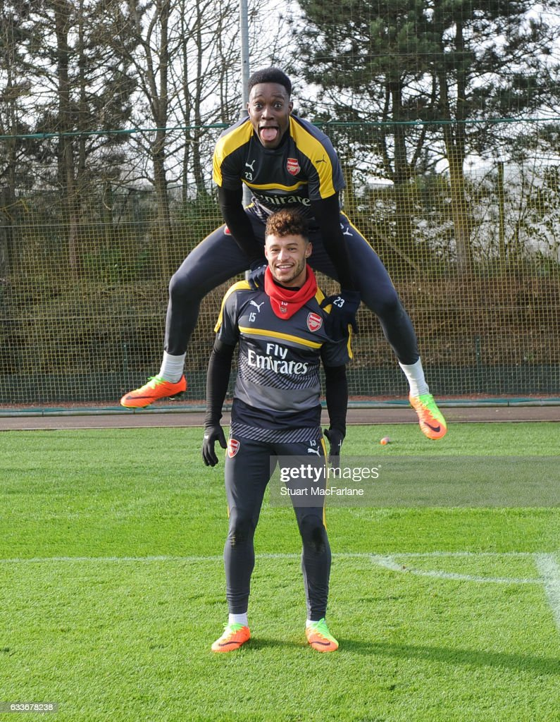 Arsenal's Danny Welbeck and Alex Oxlade-Chamberlain joke around after a training session at London Colney on February 3, 2017 in St Albans, England.