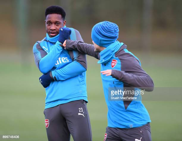 Arsenal's Danny Welbeck and Jack Wilshere mess around before a training session at London Colney on December 30 2017 in St Albans England