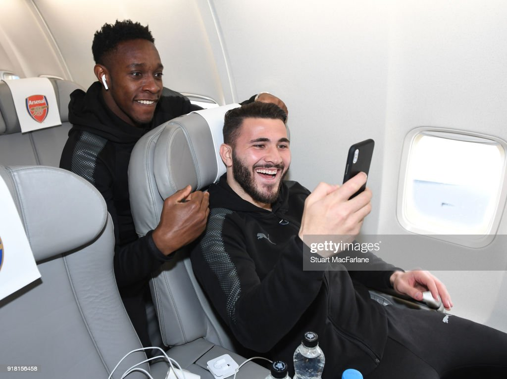 Arsenal's Danny Welbeck and Sead Kolasinac on the team flight at Luton Airport on February 14, 2018 in Luton, United Kingdom.