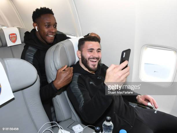 Arsenal's Danny Welbeck and Sead Kolasinac on the team flight at Luton Airport on February 14 2018 in Luton United Kingdom