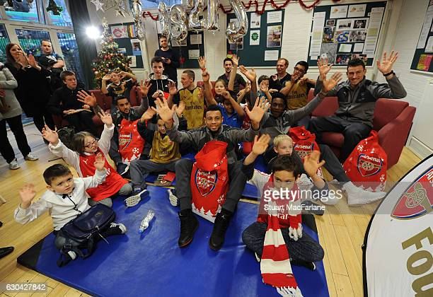 Arsenal's Danny Welbeck, Francis Coquelin, Theo Walcott and Laurent Koscielny during a visit to charity Centre 404 on December 22, 2016 in London,...
