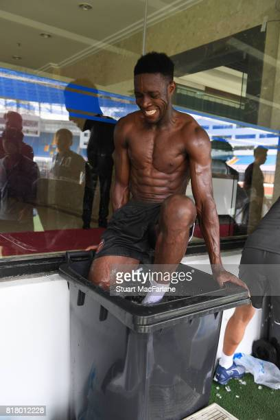 Arsenal's Danny Welbeck gets into an ice bath after a training session in Shanghai on July 18 2017 in China