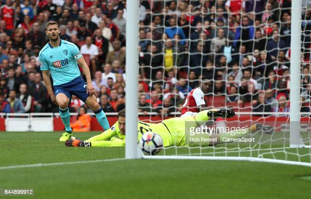 Arsenal's Danny Welbeck scores his side's third goal past Bournemouth's Asmir Begovic during the Premier League match between Arsenal and AFC...