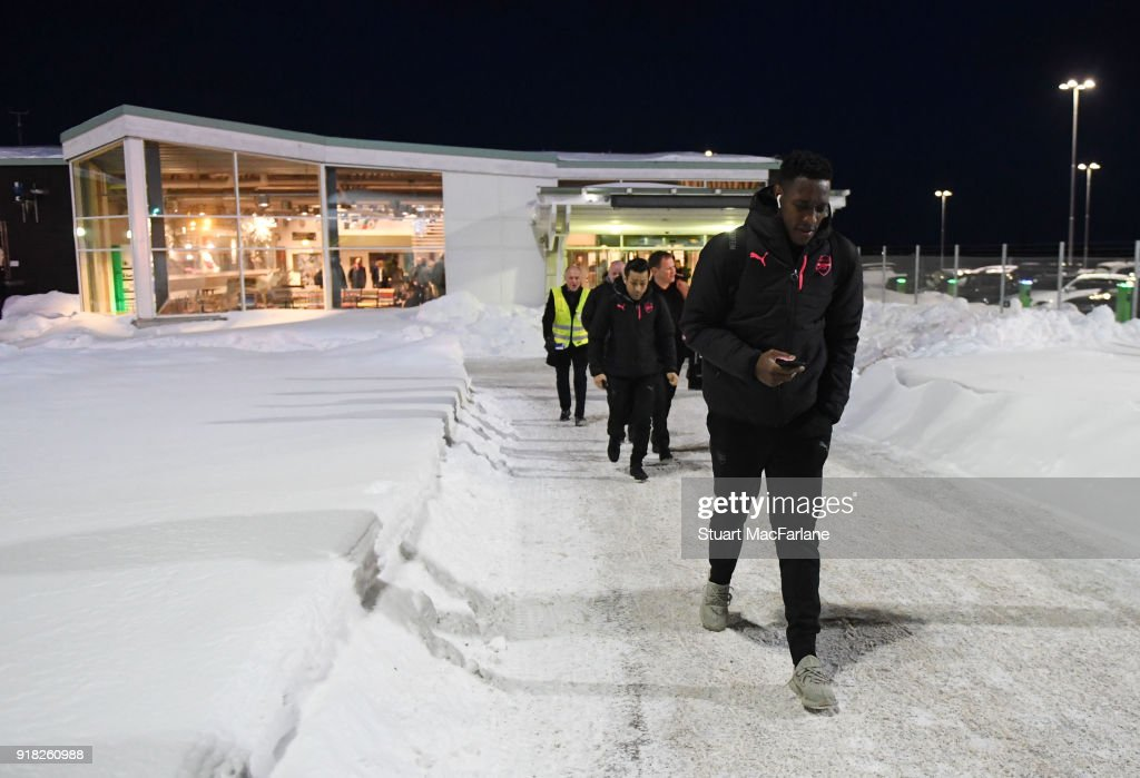 Arsenal's Danny Welbeck walks from the terminal to team bus at Ostersund airport on February 14, 2018 in Ostersund, Sweden.