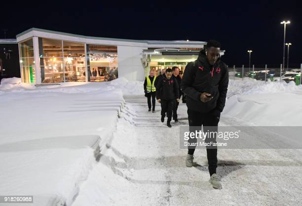 Arsenal's Danny Welbeck walks from the terminal to team bus at Ostersund airport on February 14 2018 in Ostersund Sweden