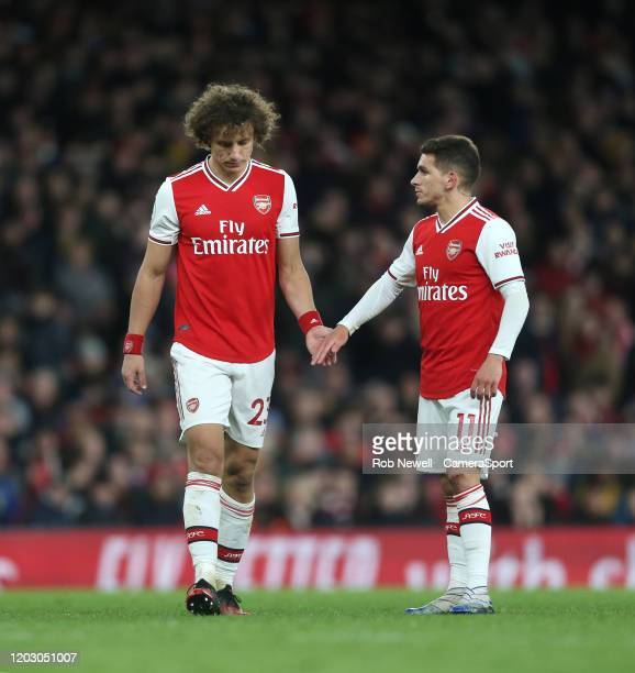 Arsenal's David Luiz and Lucas Torreira during the Premier League match between Arsenal FC and Everton FC at Emirates Stadium on February 23 2020 in...