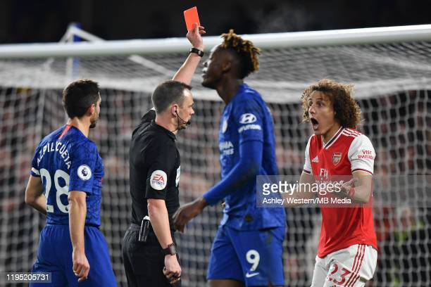 Arsenal's David Luiz is shown a red card by Referee Stuart Attwell during the Premier League match between Chelsea FC and Arsenal FC at Stamford...