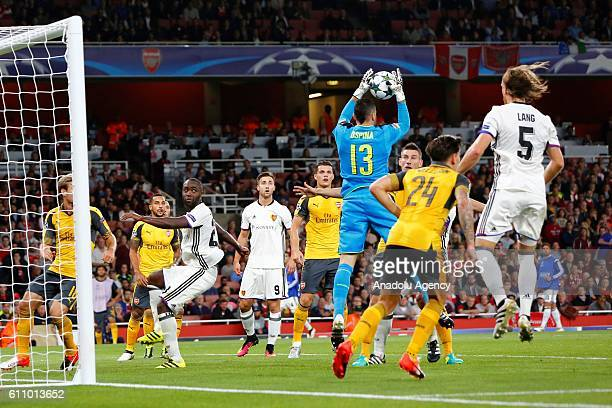 Arsenals David Ospina vies with Basel's Michael Lang during Champions League Group A match between Arsenal FC and FC Basel at Emirates Stadium on...