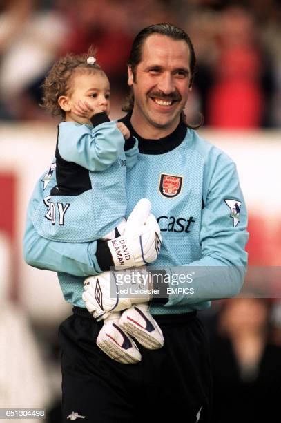Arsenal's David Seaman smiles to the Highbury crowd whilst holding his young daughter Georgina during his Testimonial game
