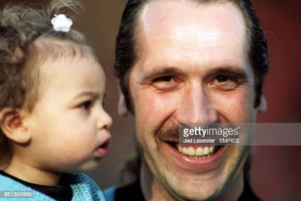 Arsenal's David Seaman smiles whilst holding his young daughter Georgina before his Testimonial game