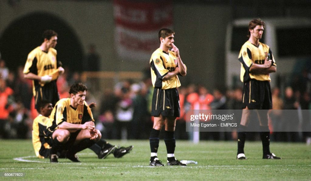 Arsenal's Davor Suker, Silvinho and Tony Adams stand numbly after losing the UEFA Cup Final