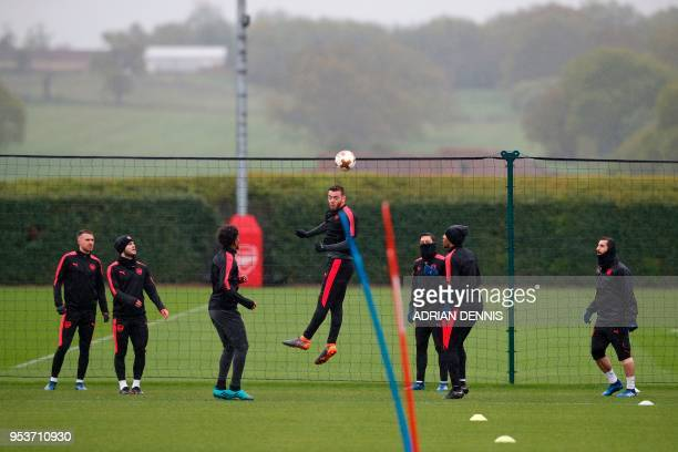 Arsenal's defender Calum Chambers jumps to head the ball takes part in a training session at the club's complex in London Colney on May 2 2018 on the...