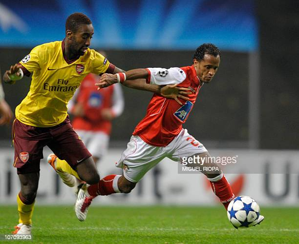Arsenal's defender from Swiss Johan Djourou vies with SC Braga's Brazilian midfielder Leandro Salino during their UEFA Champions League football...