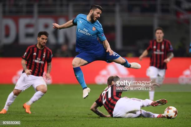 Arsenal's defender Sead Kolasinac of Bosnia and Herzegovina fights for the ball with AC Milan's midfielder Lucas Biglia from Argentina during the...