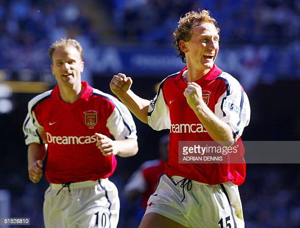 Arsenal's Dennis Bergkamp and Ray Parlour celebrate after Parlour scored the opening goal during the The FA Cup final against Chelsea at The...