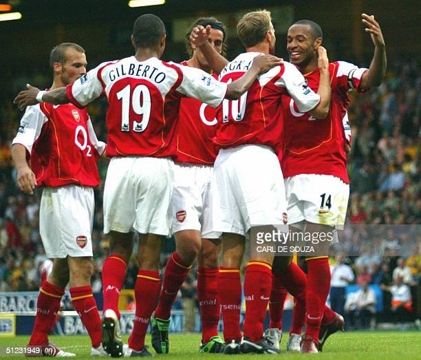 Arsenal's Dennis Bergkamp celebrates his goal with Captain Frenchman Thierry Henry against Norwich during their Premiership match 28th August 2004 at...