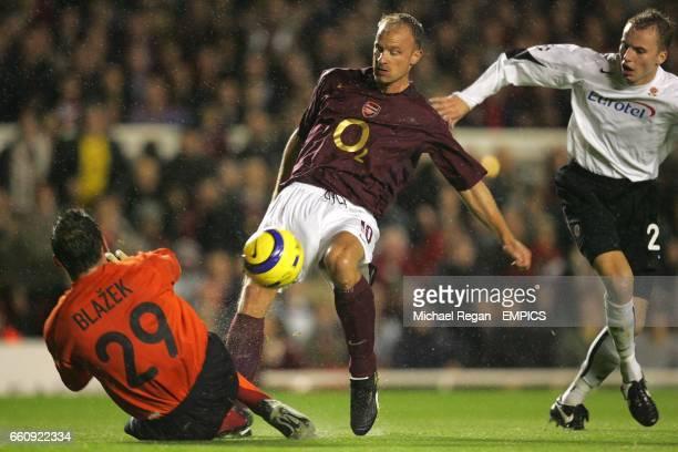 Arsenal's Dennis Bergkamp has his shot saved by Sparta Prague's Jaromir Blazek as Martin Hasek