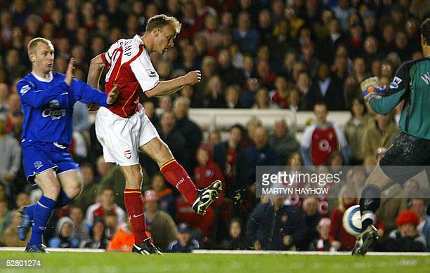 Arsenal's Dennis Bergkamp scores his side's sixth goal against Everton during their Premiership football match at Highbury in London 11 May 2005...
