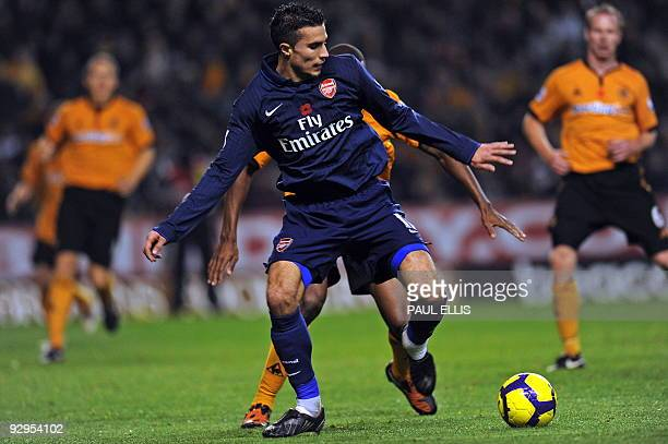 Arsenal's Dutch forward Robin van Persie in action during the English Premier League football match between Wolverhampton Wanderers and Arsenal at...