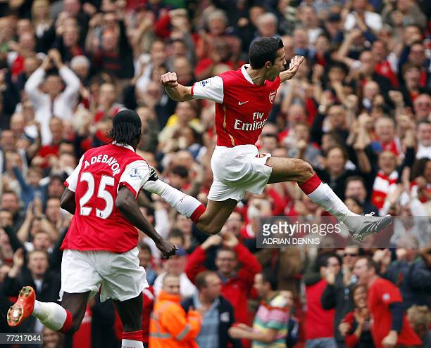 Arsenal's Dutch player Robin van Persie celebrates scoring the opening goal against Sunderland during a Premiership football match at The Emirates...