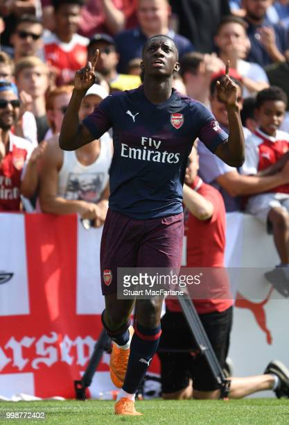 Arsenal's Eddie Nketiah celebrates his goal during the preseason friendly between Boreham Wood and Arsenal at Meadow Park on July 14 2018 in...
