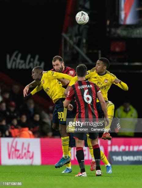 Arsenal's Eddie Nketiah Joe Willock battles with Bournemouth's Steve Cook during the FA Cup Fourth Round match between Bournemouth and Arsenal at...