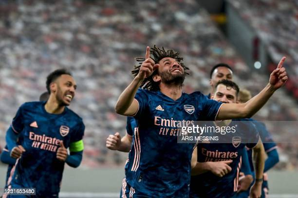 Arsenal's Egyptian midfielder Mohamed Elneny celebrates after scoring a goal during the UEFA Europa League round of 16 first-leg football match...