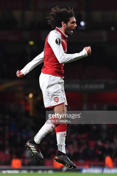 Arsenal's Egyptian midfielder Mohamed Elneny celebrates scoring the team's sixth goal during the Europa League Group H stage football match between...