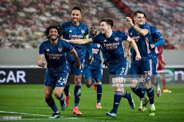Arsenal's Egyptian midfielder Mohamed Elneny celebrates with teammates after scoring a goal during the UEFA Europa League round of 16 first-leg...