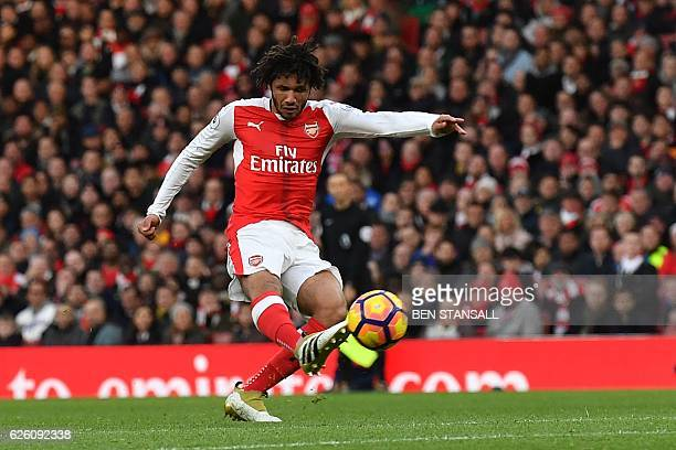 Arsenal's Egyptian midfielder Mohamed Elneny has an unsuccessful shot during the English Premier League football match between Arsenal and...
