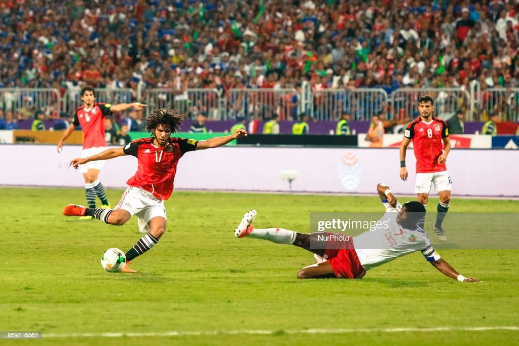 Arsenal's Egyptian midfielder Mohamed Elneny (L) in action during the World Cup 2018 Africa qualifying match between Egypt and Congo at the Borg el-Arab stadium in Alexandria on October 8, 2017. Egypt won 2-1.