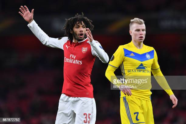 Arsenal's Egyptian midfielder Mohamed Elneny reacts to a missed oppurtunity at goal during the Europa League Group H stage football match between...
