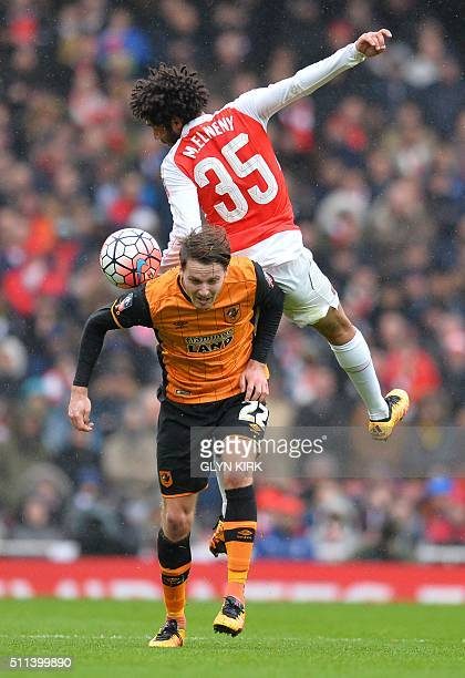 Arsenal's Egyptian midfielder Mohamed Elneny vies with Hull City's English midfielder Nick Powell during the FA cup fifth round football match...