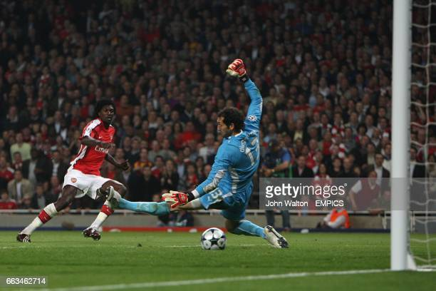 Arsenal's Emmanuel Adebayor scores the second goal past Villarreal's goalkeeper Diego Lopez
