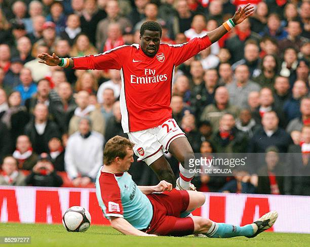 Arsenal's Emmanuel Eboue of Ivory Coast and Burnley's Scottish player Steven Caldwell vie during their FA Cup fifth round match at home to Arsenal at...