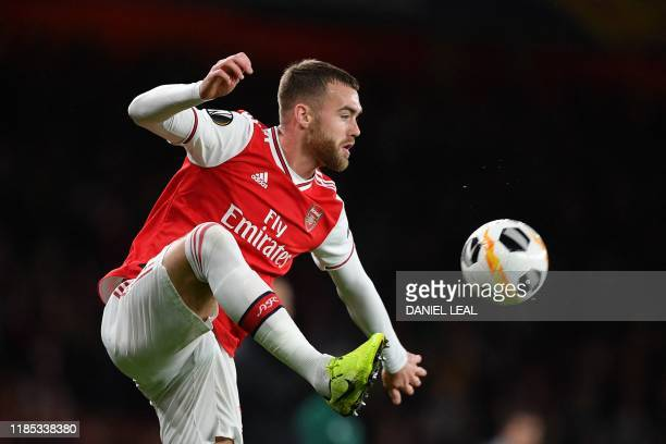 Arsenal's English defender Calum Chambers controls the ball during their UEFA Europa league Group F football match between Arsenal and Eintracht...
