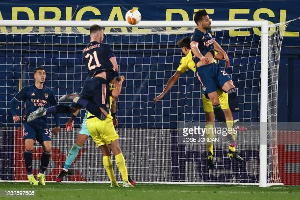 Arsenal's English defender Calum Chambers jumds for the ball during the Europa League semi-final first leg football match between Villarreal and...