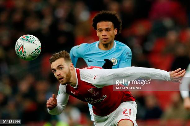 TOPSHOT Arsenal's English defender Calum Chambers vies with Manchester City's German midfielder Leroy Sane during the English League Cup final...