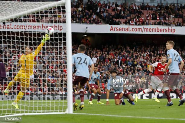 Arsenal's English defender Calum Chambers watches as his shot beats Aston Villa's English goalkeeper Tom Heaton for their second goal during the...