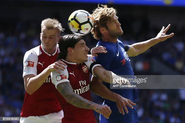 Arsenal's English defender Rob Holding Arsenal's Spanish defender Hector Bellerin and Chelsea's Spanish defender Marcos Alonso vie for the ball...