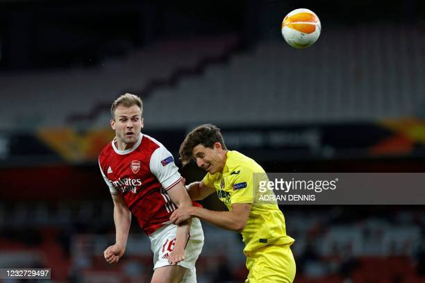 Arsenal's English defender Rob Holding heads this effort wide under pressure from Villarreal's Spanish defender Pau Torres during the UEFA Europa...