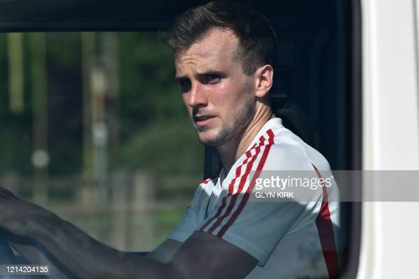 Arsenal's English defender Rob Holding leaves Arsenal's Colney training centre north of London on May 20 2020 as training continues for Premier...